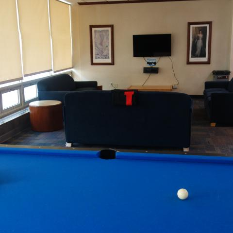 Sherman House Common Room with pool table, furniture, coffee tables, and television