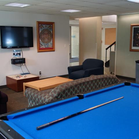 Cutler House Common Room with pool table, furniture, and television