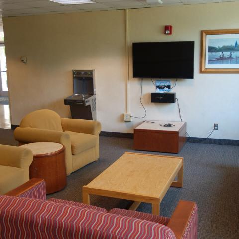 Pierce House Common Room showing furniture, television, and wall-mounted water bottle filler