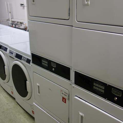 Kusch House Basement Laundry Room with washers and stacked dryers