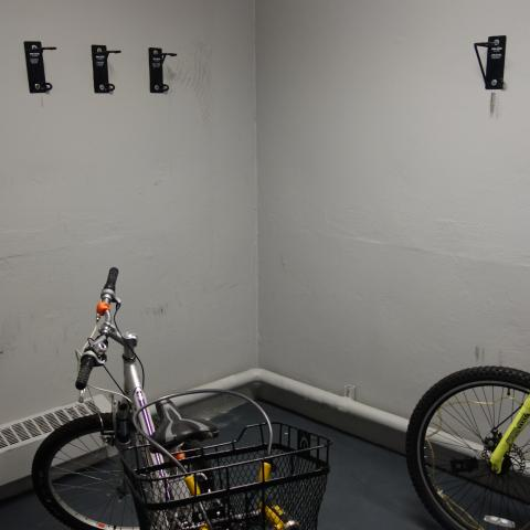 Glaser House Basement Bike Storage with wall-mounted hooks and two bikes