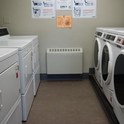 Howe House 1st Floor Laundry Room with washing and drying machines