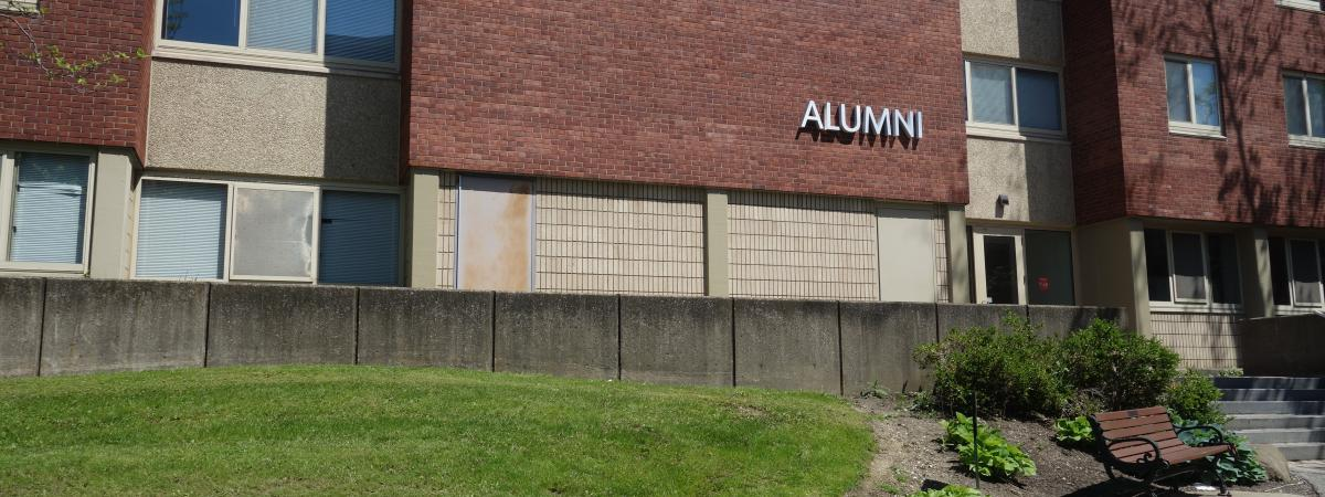 Alumni House exterior showing main entrance and building name plates