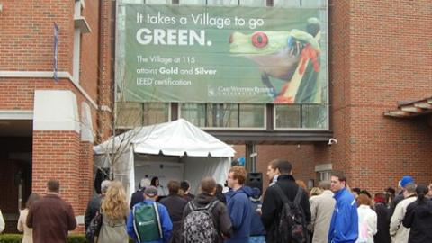 Village at E 115th with LEED sign