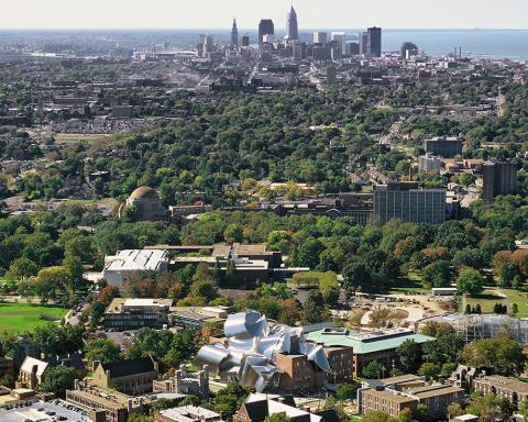 Aerial view of downtown Cleveland, with Case Western Reserve University campus in foreground and Lake Erie in background