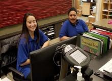 SRV Area Office front desk with two housing customer service assistants